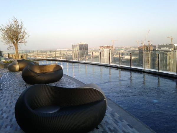 hyatt-capital-gate-abu-dhabi-pool-sitting-area-by-the-pool