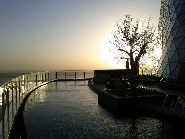 hyatt-capital-gate-abu-dhabi-pool-sun-set